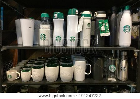 BANGKOK THAILAND - 11 JUN 2017: Lot of Starbucks coffee mug on shelf in Starbucks coffee shop in Bangkok