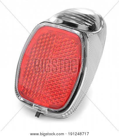 Bicycle light reflector on white background