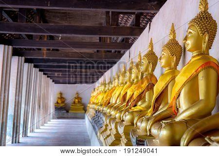Aligned Buddha statues at Wat Phutthaisawan, Ayuthaya, Thailand.