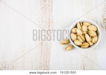 Pistachios On A  Wooden Table