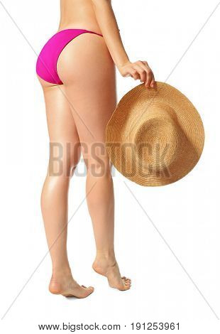 Beautiful young woman in bikini and with hat on white background