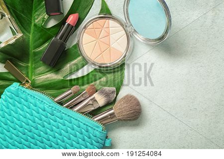 Composition with cosmetics and green tropical leaf on light background. Natural cosmetics concept