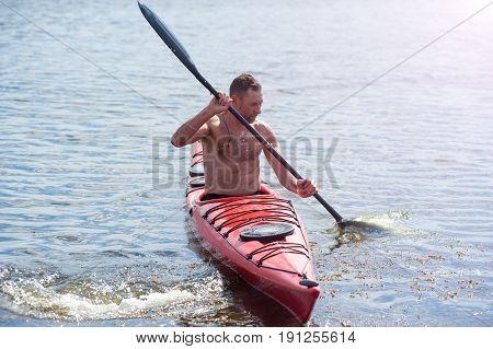 Man Swims On A Red Kayak 02