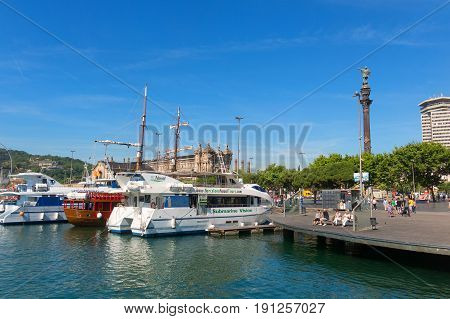 Boats Moored Near The Columbus Statue, Which Run Along The Coast Of Barcelona. Spain