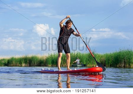 Sup Stand Up Man With A Paddle 03