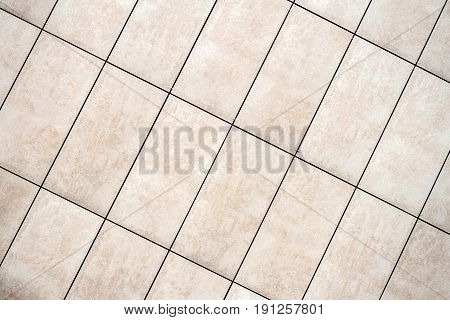 Detail of light beige tile wall texture background