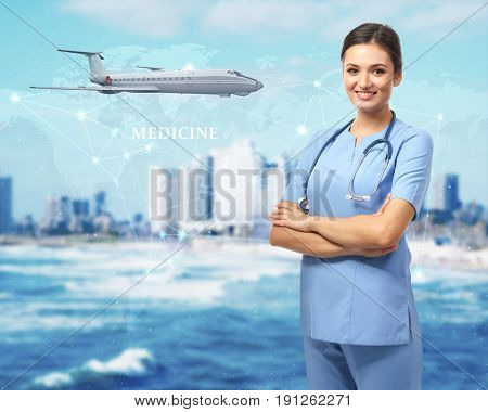 Travel nursing concept. Yong doctor on cityscape background