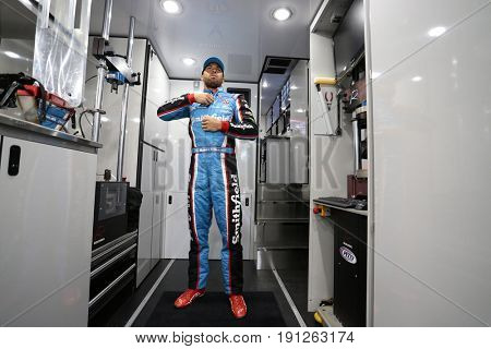 June 09, 2017 - Long Pond, PA, USA: Darrell Wallace, Jr. (43) gets suited up prior to practice for the Pocono 400 at Pocono Raceway in Long Pond, PA.