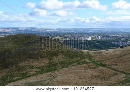 Looking down at Edinburgh Scotland from the Scottish Highlands Foothills.
