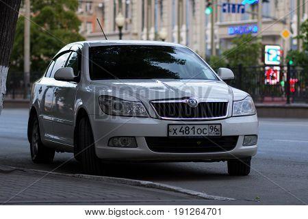 Ekaterinburg Russia June 11 2017 - Škoda Octavia white on Lenin Street in the urban environment in the evening