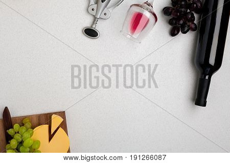 Wine, glasses and corkscrew over white background. Top view with copy space