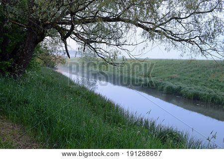 Small river with haze in Finnish summer night