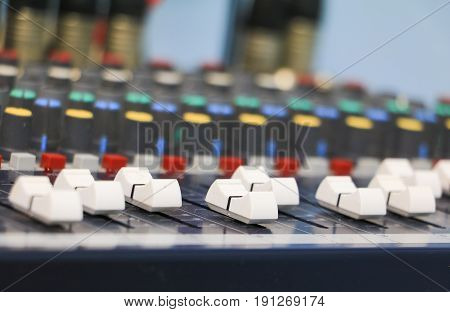 sound mixer control with covered in dust dirty. select focus with shallow depth of field