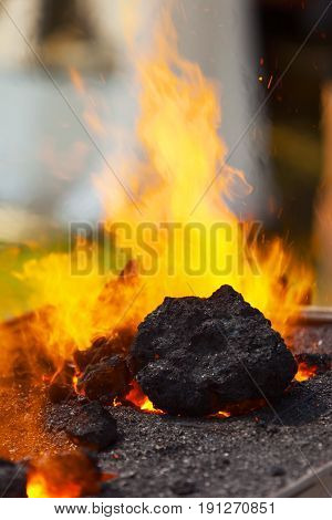 Burning of coal in smithy