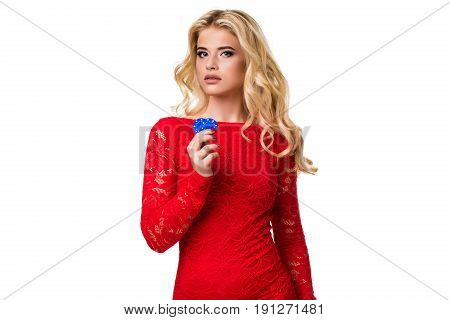 Caucasian young woman with long light blonde hair in evening outfit holding playing chips. Isolated on white background. Poker