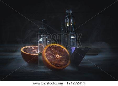 Black Vaporizer In The Smoke With Sliced Orange