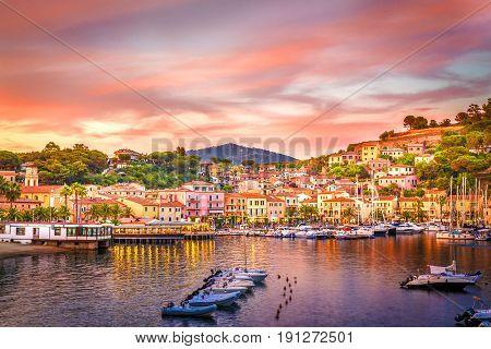 Harbor and village Porto Azzurro at sunset Elba islands Tuscany Italy.