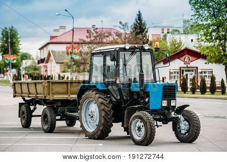 Dobrush, Belarus - May 9, 2017: Tractor The MTZ-82 The Belarus With Cart - A Brand Of Universal Wheeled Tractor Wheels Produced By The Minsk Tractor Plant From 1974 To The Present