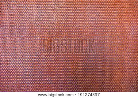 Steel grating rusty with circular holes background texture