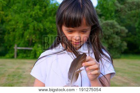 Beautiful girl have fun in the park .