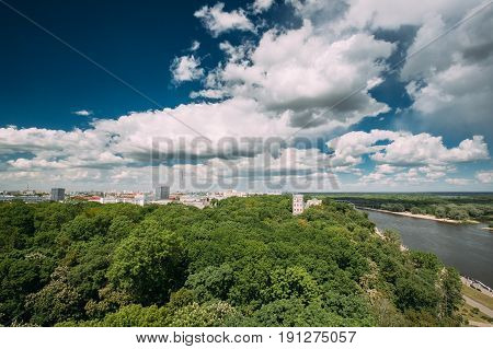Gomel Belarus. Top Aerial View Of Rumyantsevs And Paskeviches Palace And Park Ensemble, Famous Monument Of Classicism, Landmark On Bank Of Sozh River Among Green Trees Crowns In Summer Under Blue Sky