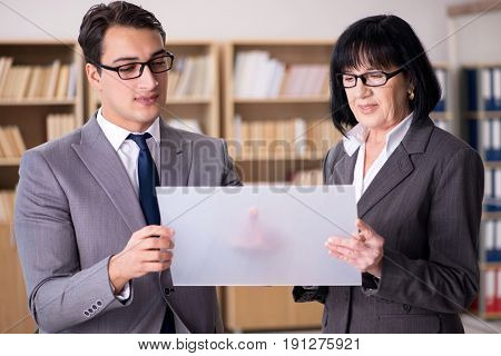 Business couple discussing business results on tablet