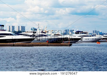 Luxurious yacht for walks and excursions is prvvartovana in Moscow river Russia. Concept travel in Moscow and St. Petersburg. Shine of the sun.
