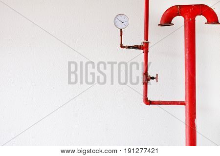 Pressure gauge and water pipe valve water on white wall