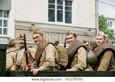 Gomel, Belarus - May 9, 2017: Group Of Re-enactos Dressed As Russian Soviet Soldiers Of World War II Sitting In Truck ZIS-5V And Taking Part In Parade During Celebration Of Victory Day 9 May