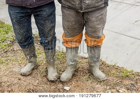 Detail of Two workers in wellingtons - Poland.