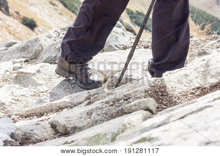 Hiking woman with trekking boots on the trail. Tatras Mountains.