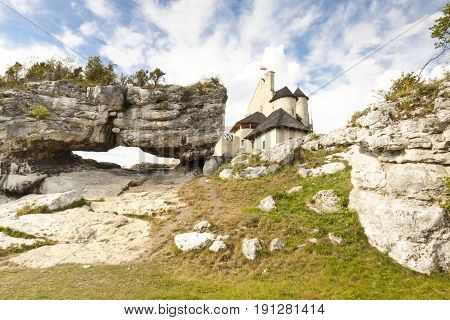 Big limestone rock in bacground view on old Bobolice castle - Poland Silesia.
