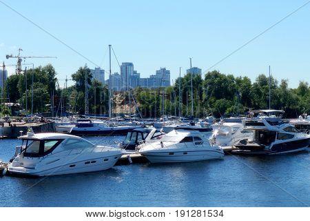 Boat mooring in the river port. Docked boat.