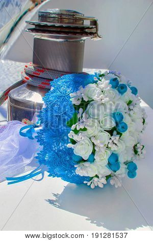 Wedding. Bridal bouquet on a background winch on a yacht. the bride's bouquet