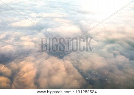 Aerial view Landscape sky with cloud of the city as seen from an airplane or a bird eye view