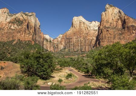 An elevated view of some peaks at Zion National Park in Utah including peaks that make up the iconic Court of the Patriarchs.