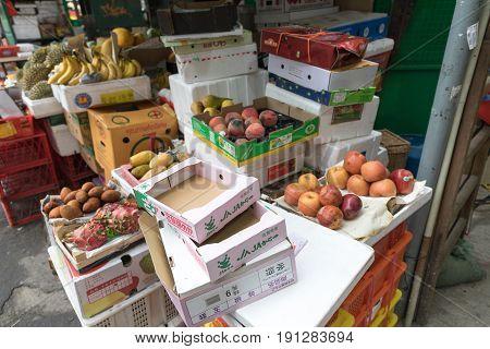 KOWLOON HONG KONG - APRIL 21 2017: Spoiled Fruits and Vegetables at Street Market in Kowloon Hong Kong.