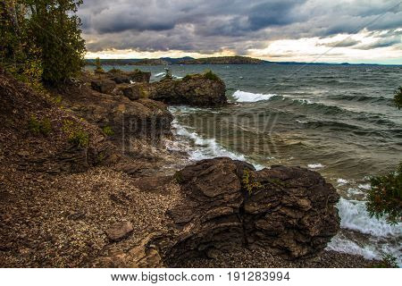 Rocky Coast On Lake Superior. Rocky outcroppings and waves crashing on the coast of Lake Superior. Presque Isle Park. Marquette, Michigan.