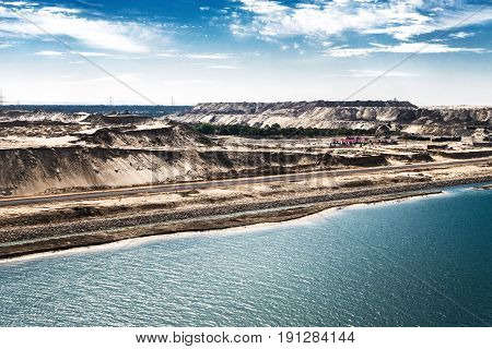 The Suez Canal and the in August 2015 newly opened Eastern Expansion Canal with raised sand masses high-contrast picture