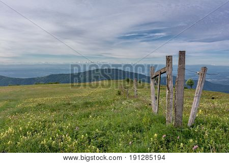 French countryside - Vosges. Panoramic view to a valley in the Vosges and a fence on a pasture. In the background you can admire the Alps.