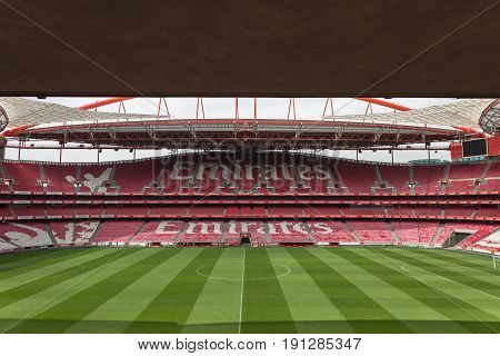 Lisbon, Portugal - july 2016: View of Da Luz Stadium: Red Empty Seating and Green Soccer Pitch - Lisbon Portugal