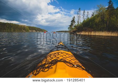 A Process Of Kayaking In The Lake Skerries, With Colorful Canoe Kayak Boat Paddling, Process Of Cano