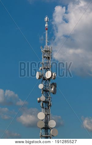 Telecommunication Towers with Satellite Dishes and Antennas