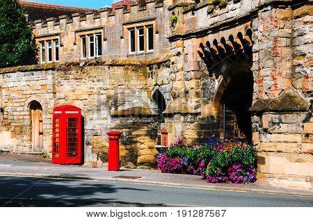 Stratford upon Avon UK. Red british telephone booth in the historical center of Stratford upon Avon UK