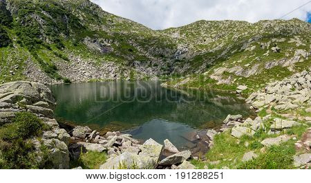 Panoramic view of mountain lake. Nero Lake above Madonna di Campiglio in Italy.