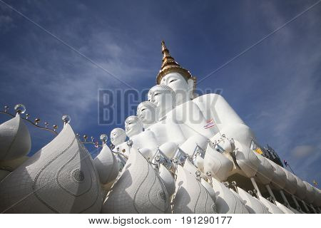 side view of Five white buddha statues sitting well alignment in front of blue sky, one of the most interesting landmark in north of Thailand