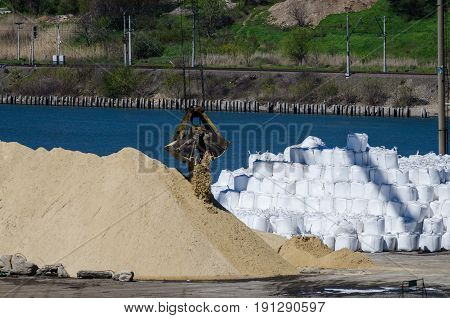 Crane Head In River Port. Heavy Cranes Unloading Sand For Bussiness. Resources Delivery