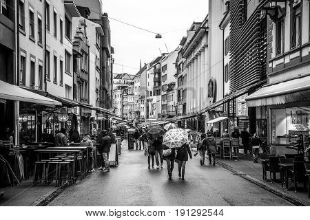 Basel, Switzerland - February 04, 2017: Black and white photo of people in one of the shopping streets in the historic city centre