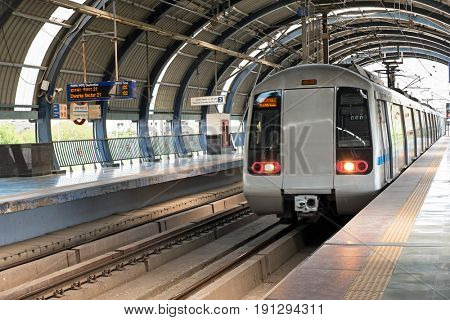 Metro arriving at Dwarka station in New Delhi India Asia