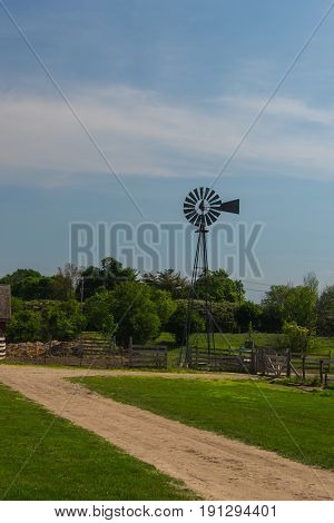 Metal Wind Mill On A Farm In The Suburbs